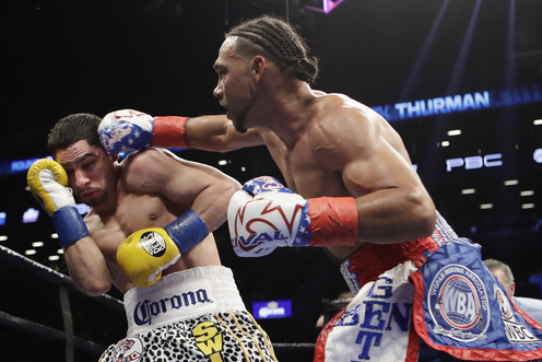 Keith Thurman beats Danny Garcia by split decision to unify titles