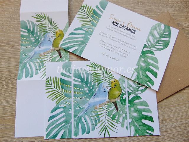 Invitaciones de boda pintadas en acuarela con periquitos y hojas de estilo tropical