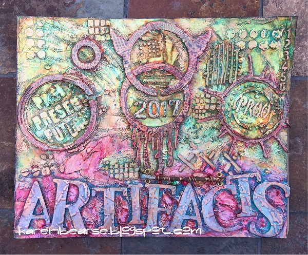 Cover of book with lots of texture painted with decoart paint in colors of copper, green, & magenta.