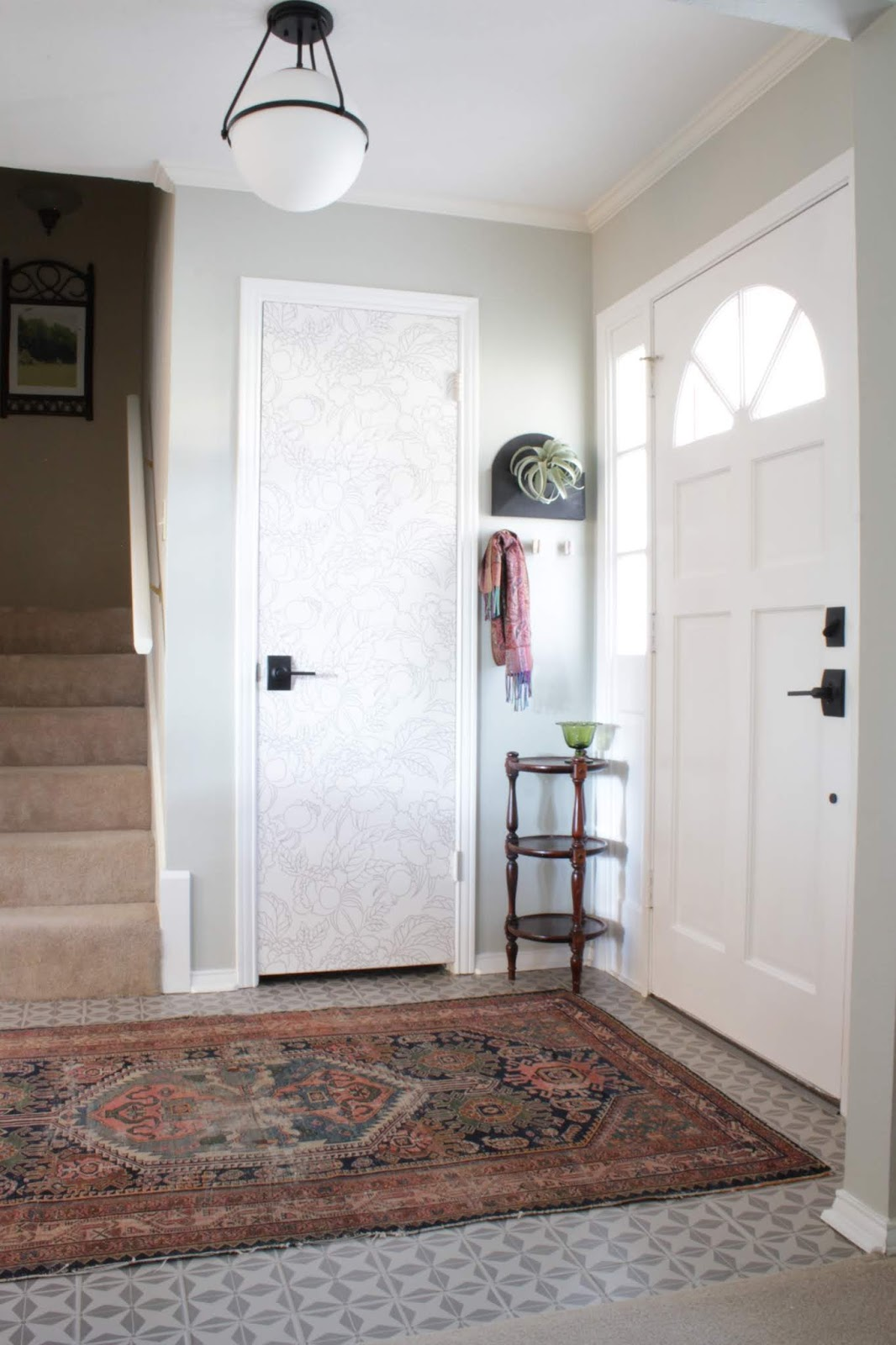 We've lived in our house a whole year!! Check out the tour and a round up of projects I've done. It's been great! | House Homemade stenciled floor, wallpapered door entryway