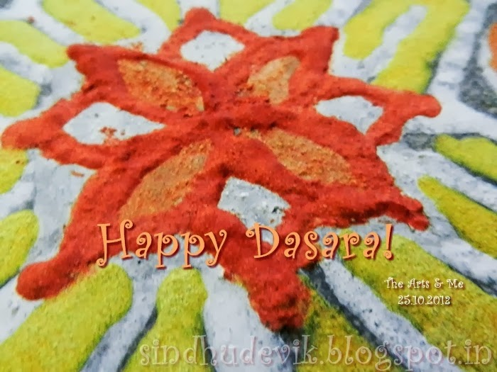 An eco-freindly floral rangoli for dassera or vijayadashami.