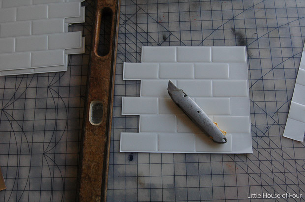 Cutting peel and stick tile with a razor blade