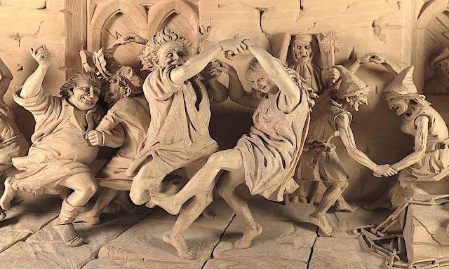 a Thomas Hall Tweedy 1860 wood carving of people dancing in joy
