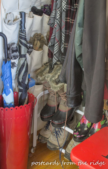 Shoe organizer, umbrella holder, pocket organizer plus lots of other great coat closet organizing ideas.