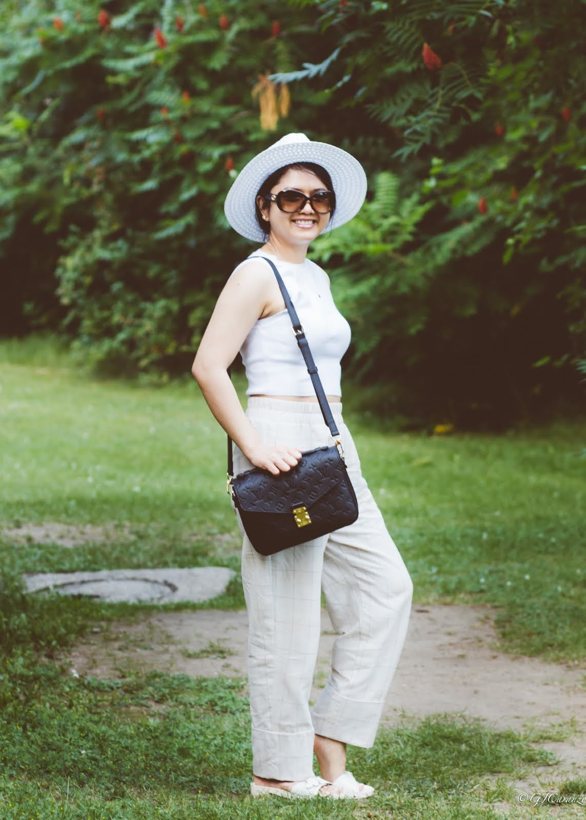 zara knit crop top_zara cuffed pants_louis vuitton pochette metis in black empreinte leather_coach bleeker sandals_gucci sunglasses_walmart sun hat