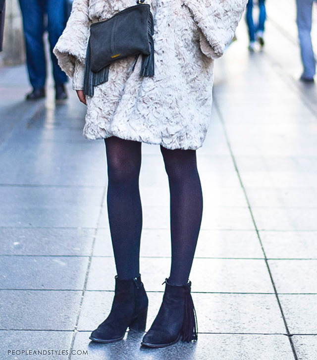 how to wear a faux fur coat and fringed ankle boots, women winter street style fashion, Iva Rožanković