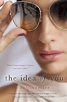 A cover of The Idea of You with a face of woman with large tinted glasses