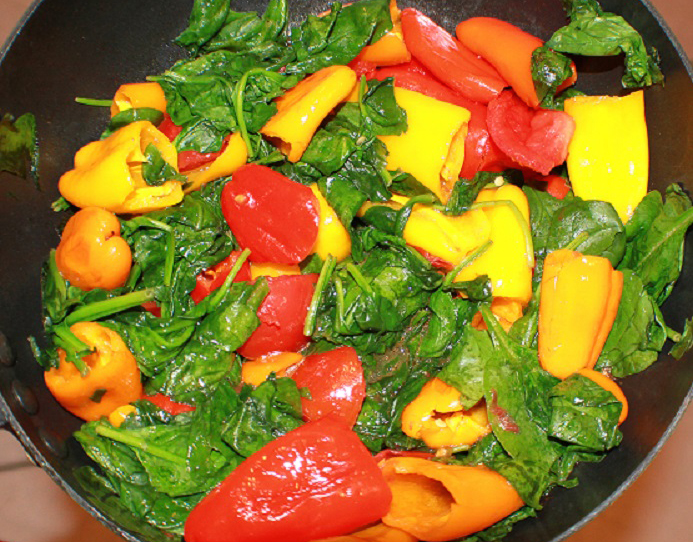 this is a pan of spinach and peppers