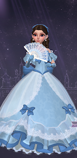 Jo in a grand blue theatrical gown with big bows and a lace fan
