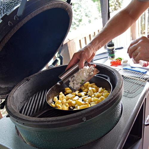 Making skillet potatoes on the Big Green Egg