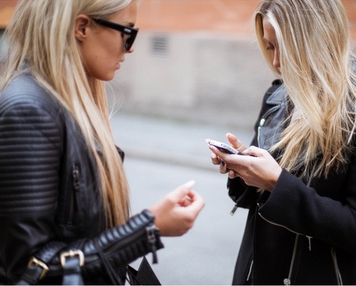 girls with black quilted leather jacket