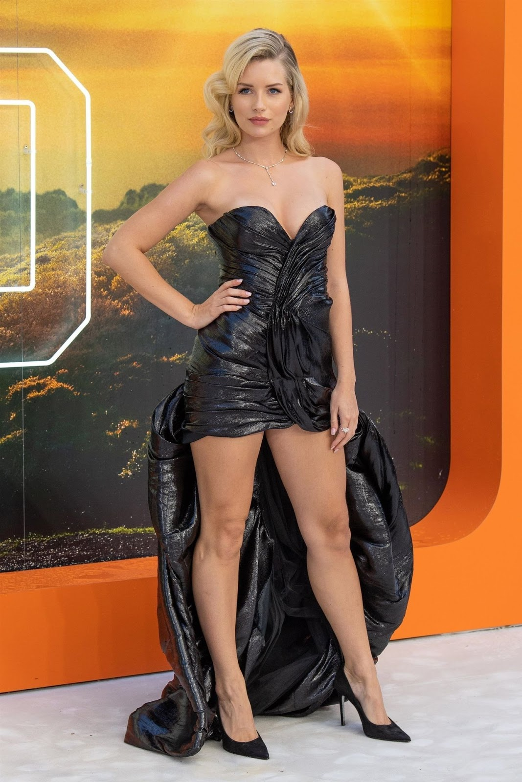 Lottie Moss turns heads in a black ruched PVC dress featuring an epic train at Once Upon A Time In Hollywood's London premiere