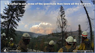 It is better to ask some of the questions than know all the answers. – James Thurber (Firefighters resting on a ridge looking on a smoke column)