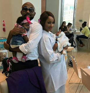 Banky W and Adesua Etomi with their 'babies' on set