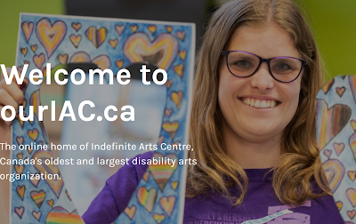 screenshot of home page for ourIAC.ca - Our Indefinite Arts Centre. Picture of woman holding up art work.