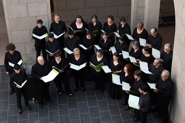 The Stairwell Carollers sing in the Atrium of the National Gallery, Ottawa