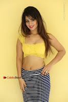 Cute Telugu Actress Shunaya Solanki High Definition Spicy Pos in Yellow Top and Skirt  0506.JPG