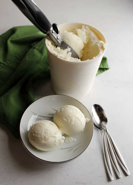 serving scoops of homemade 3 ingredient key lime sherbet into bowl