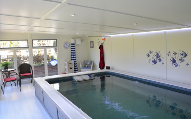 An Original Endless Pool installed in a custom pool house by Bakers Timber Buildings.