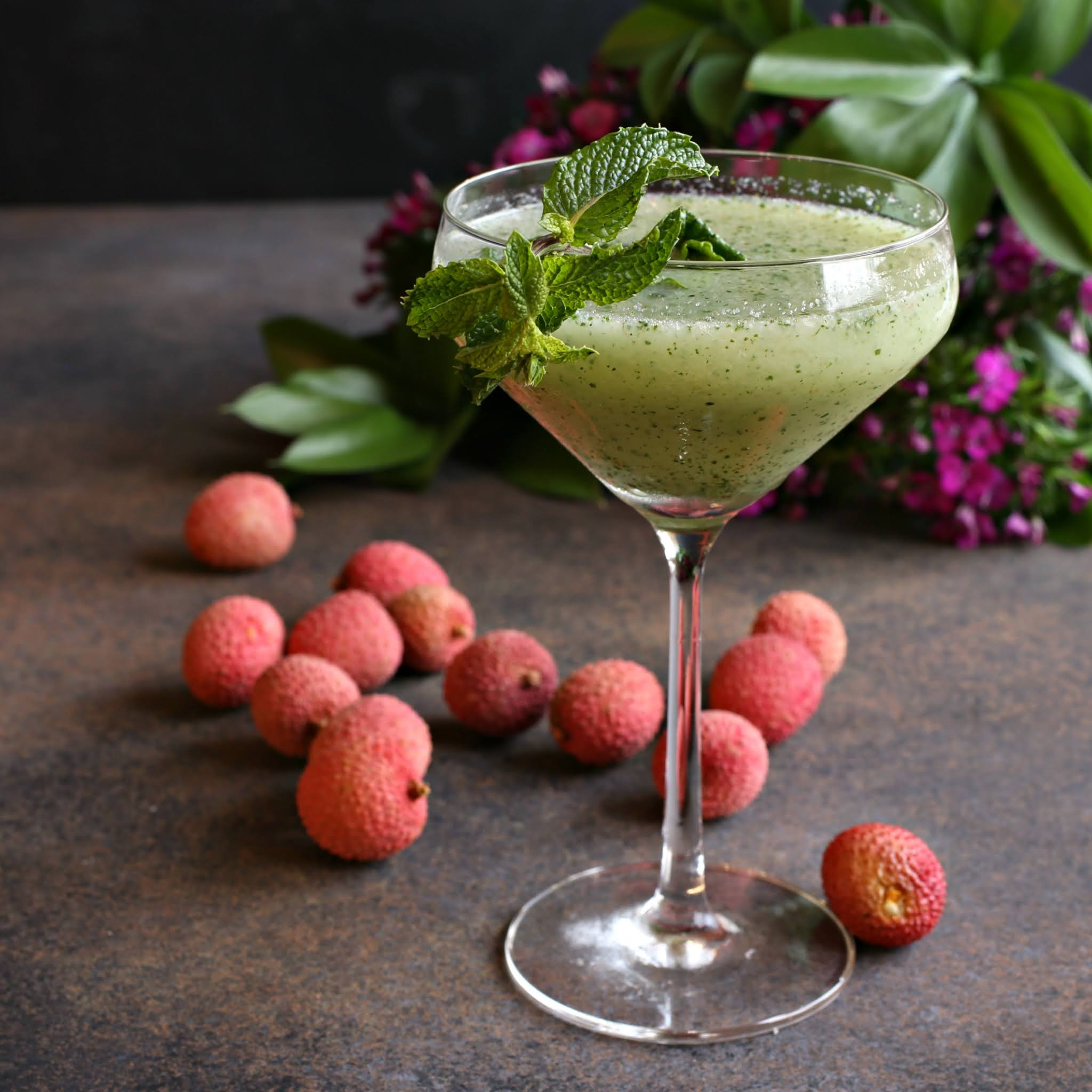 Recipe for a rum based cocktail flavored with fresh lychees, mint and elderflower.