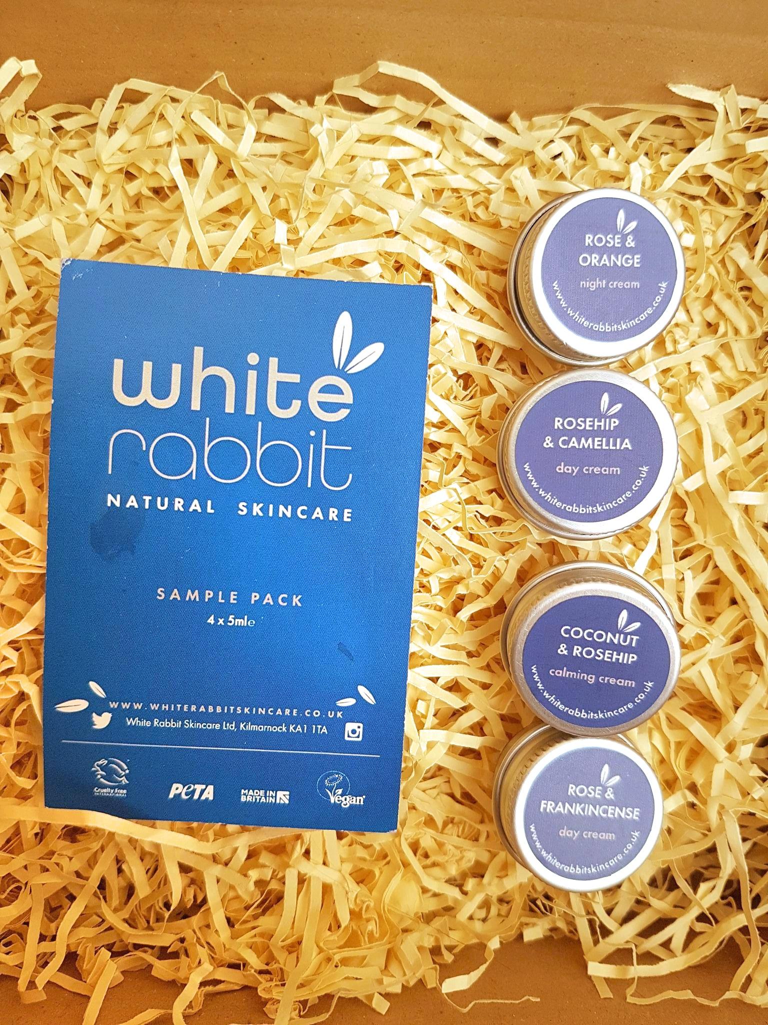 White Rabbit skincare plastic free sample set lying on yellow paper grass
