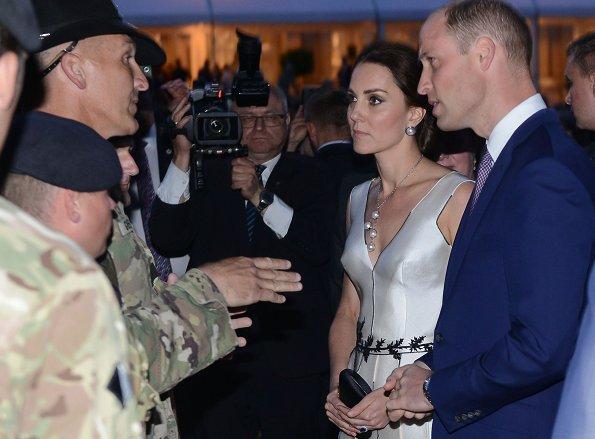 Kate Middleton wore Gosia Baczynska dress and Balenciaga earrings. Kate Middleton carried PRADA Satin Clutch
