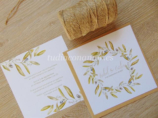 Invitaciones pintadas en acuarela con corona de ramas de olivo, perfectas para una boda de estilo rústico