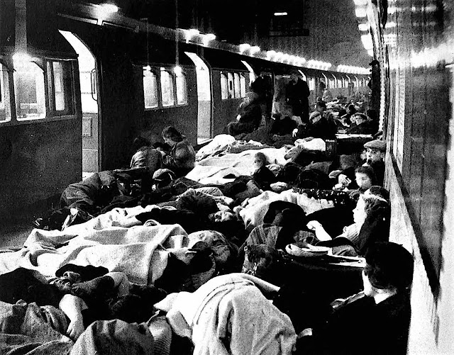 a photograph of people in the 1941 London subway waiting out a bombing