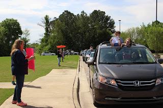 Montgomery Catholic Teachers Greet Students from Afar 1