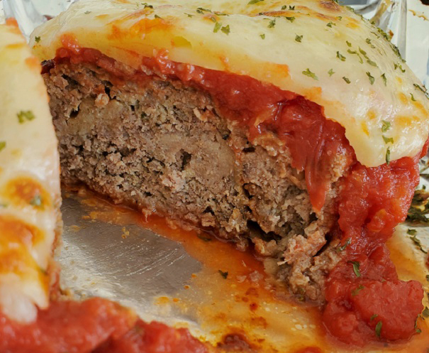 this is meatloaf topped with cheese and tomato sauce
