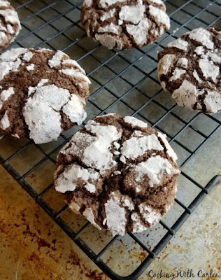 freshly baked chocolate crinkle cookies on cooling rack