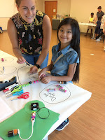 Adult and child use littleBits
