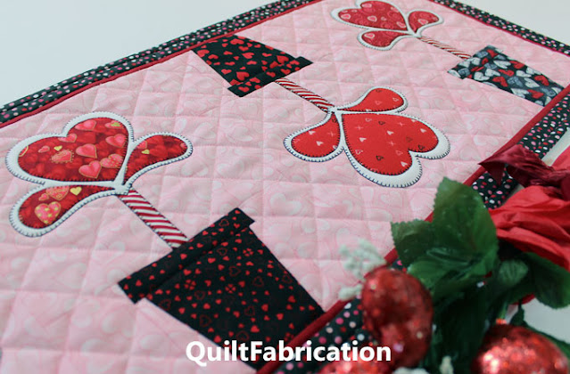 three heart flowers in flower pots on a table runner by QuiltFabrication