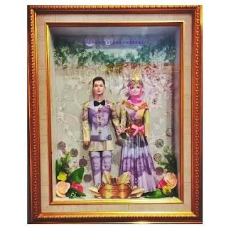 seserahan pernikahan uang boneka