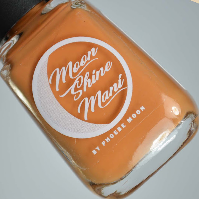 squash colored nail polish in a bottle