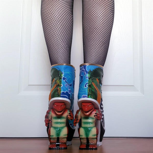 back view of legs wearing dinosaur heeled ankle boots