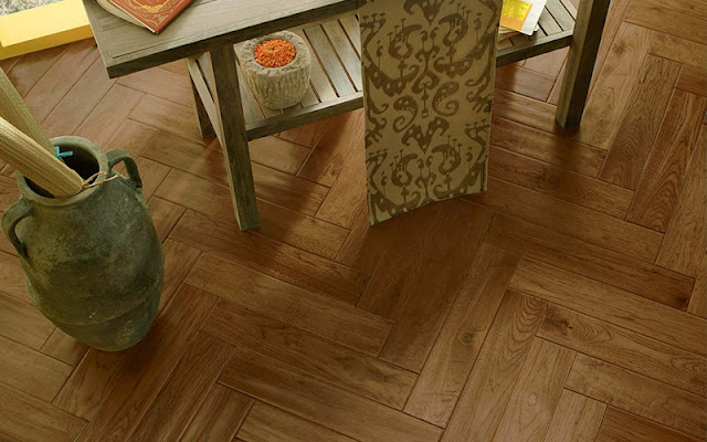 As this herringbone floor shows, the look of a hardwood floor changes based on how the planks are laid.