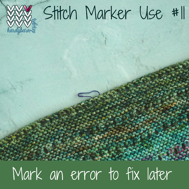 Green knitting in garter stitch with marker attached to one stitch