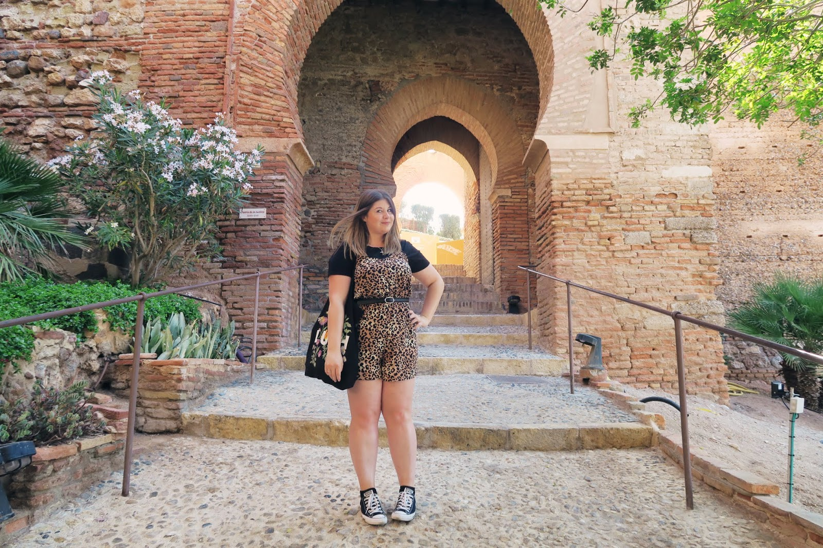 Standing in front of a row of arches inside Almeria Alcazaba
