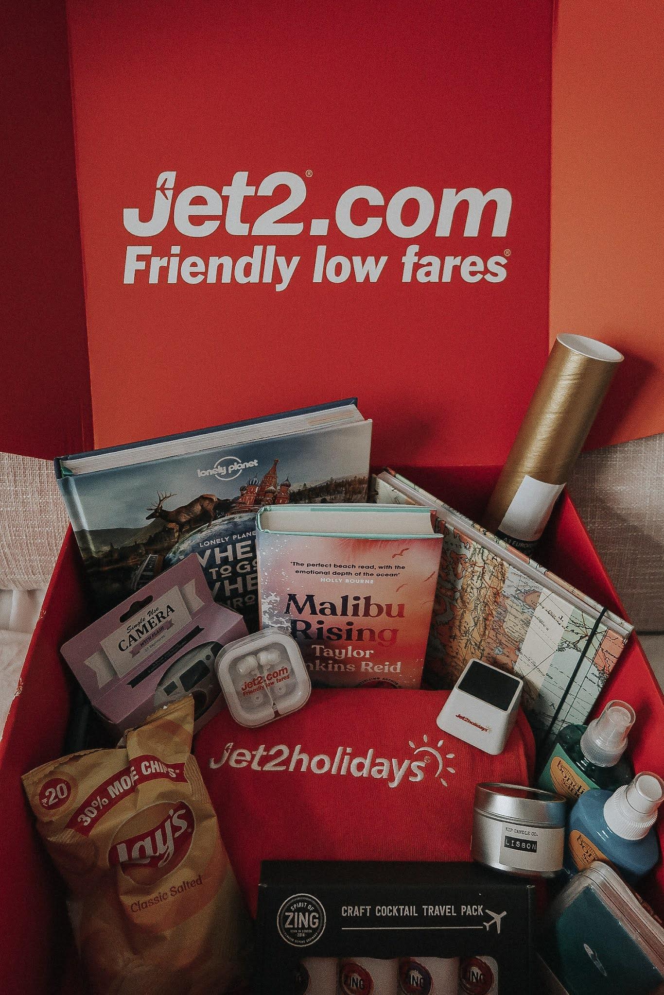A red Jet2.com box of travel essentials