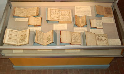 Display case with 18th century hymnals and other music books