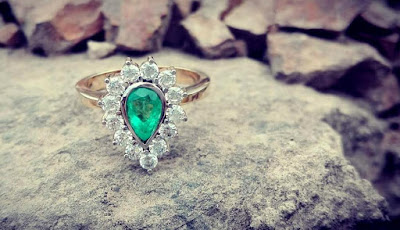 emerald set in white and yellow gol an diamonds engagement ring