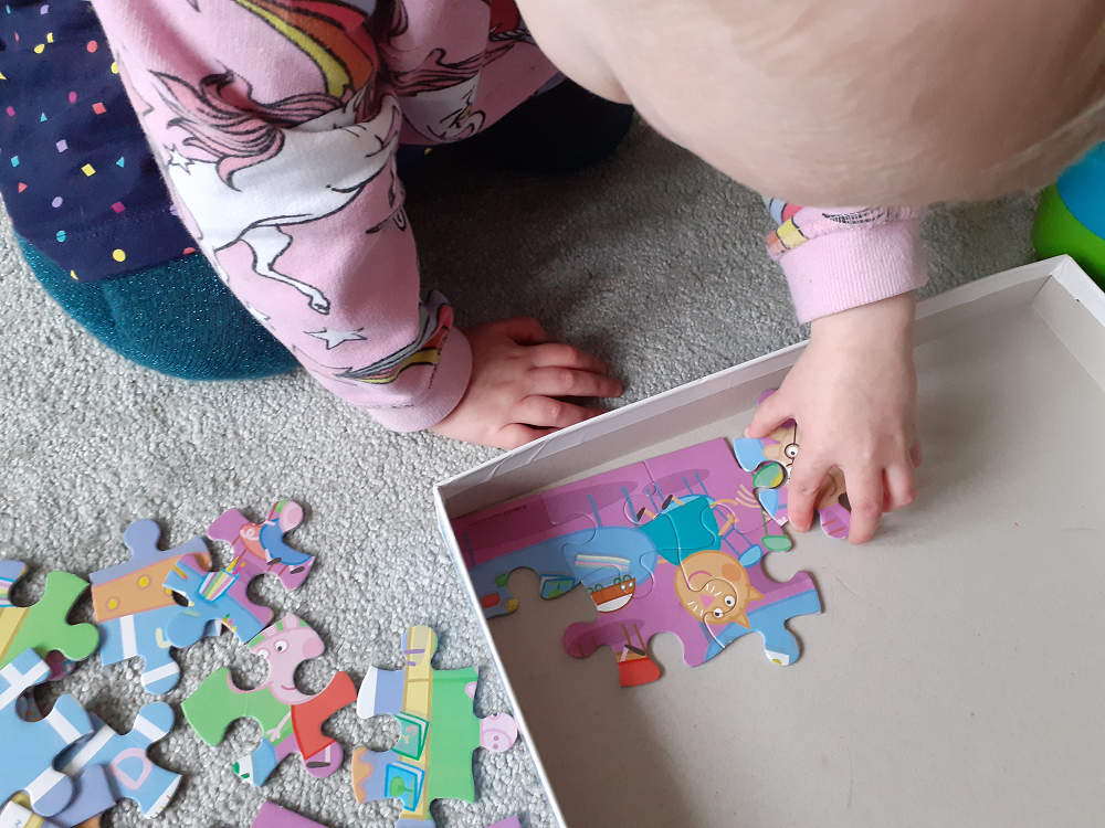 Toddler hands doing jigsaw
