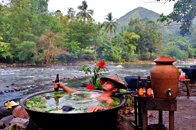 Hunk guy relaxes while having a kawa hot bath in Tibiao, Antique