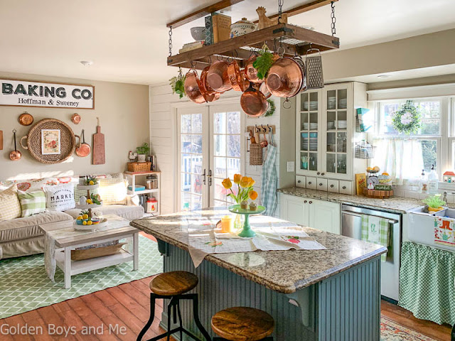 Farmhouse style kitchen with diy pot rack andspring decor - www.goldenboysandme.com