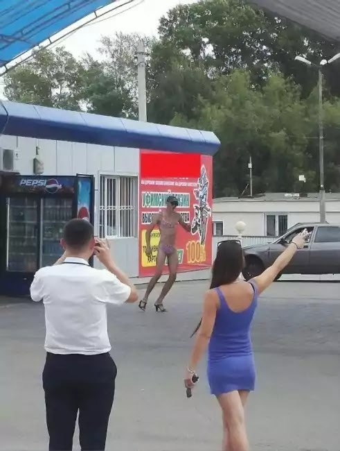 Russian Gas Station Offers Free Fuel For Those Wearing Bikini, And Men Accepted The Challenge