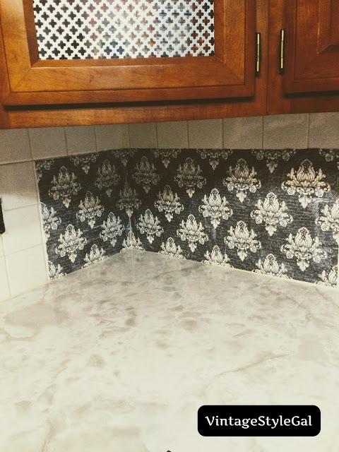 Decoupaging decorative napkins to wall