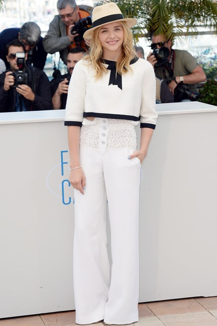 Chloe Moretz wearing an outfit by Chanel and a Maison Michel hat at Cannes 2014