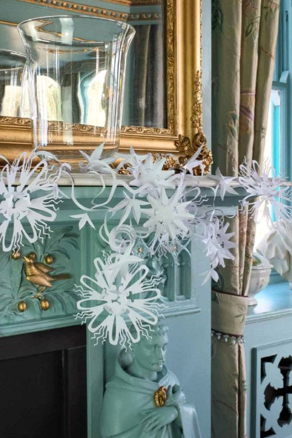 passionflower trailing paper garland displayed on mantel