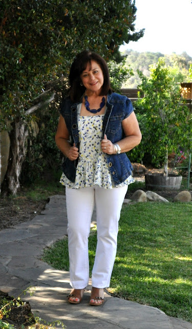 white jeans a cami and a jean vest